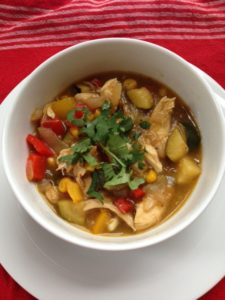 Colorful veggies and tart tomatillos liven up this easy-to-make chicken stew.